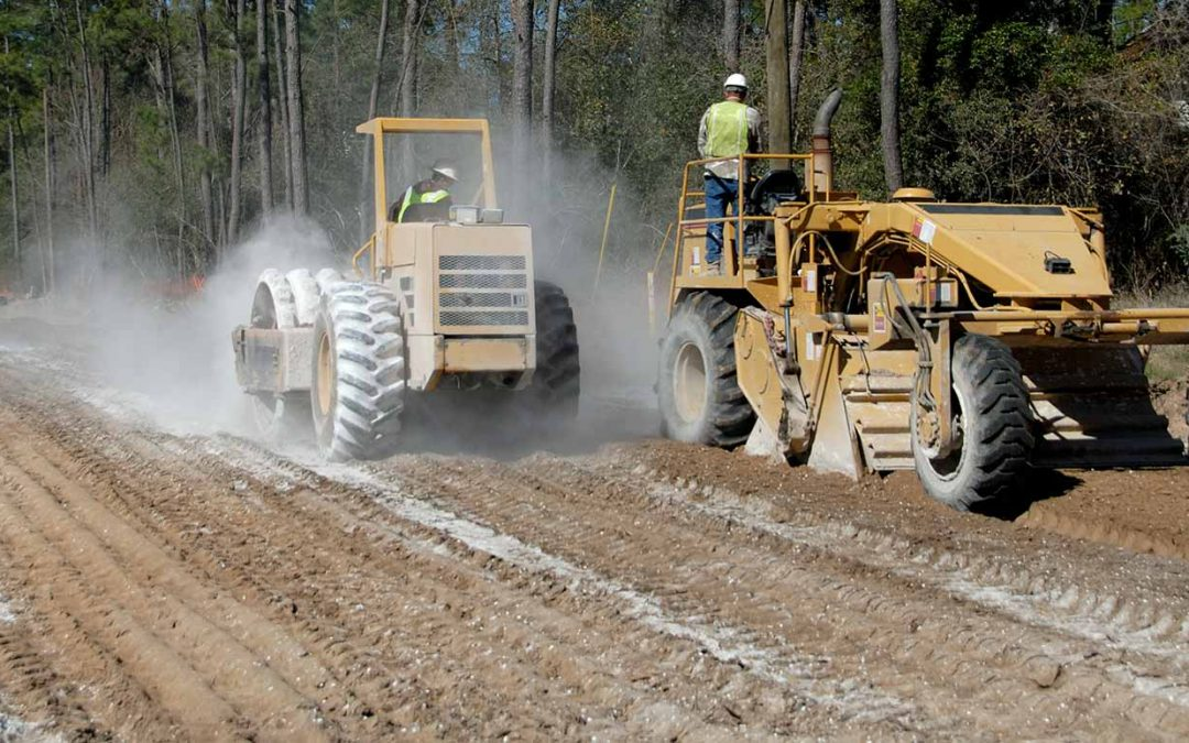 Road Construction- Tiller And Compactor Stabilizing The Soil